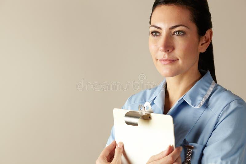 UK nurse holding clipboard stock photo