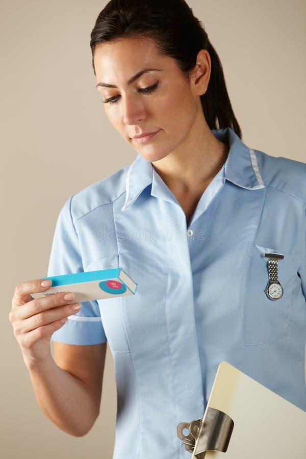 UK nurse holding prescription drug pack royalty free stock photography