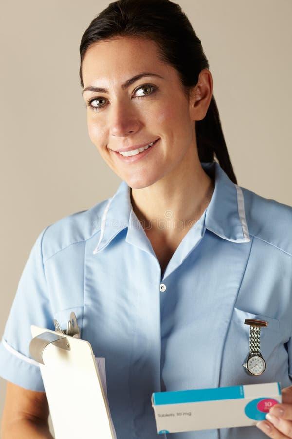UK nurse holding prescription drug pack royalty free stock photo
