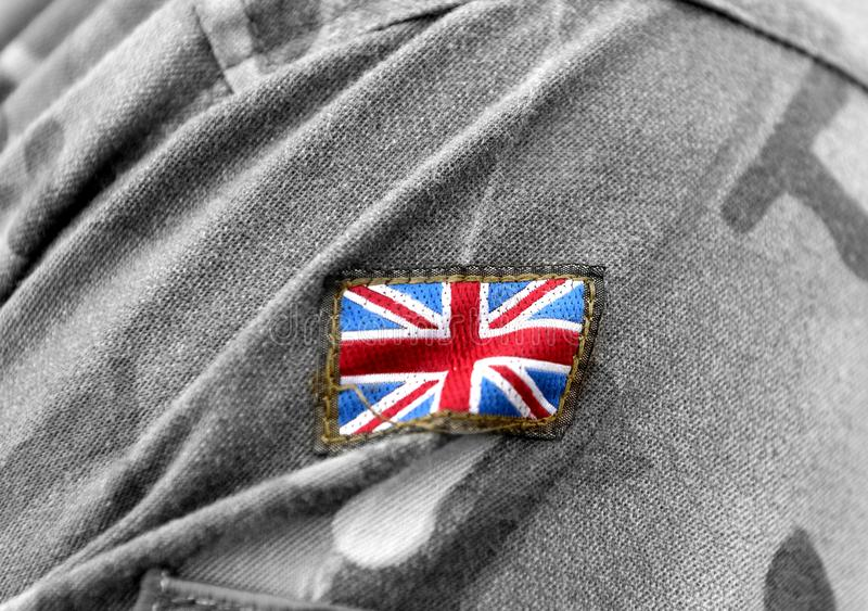 UK patch flag on soldiers arm. UK military uniform. United Kingdom troops royalty free stock images