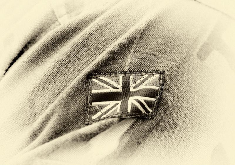 UK patch flag on soldiers arm. UK military uniform. United Kingdom troops royalty free stock photography