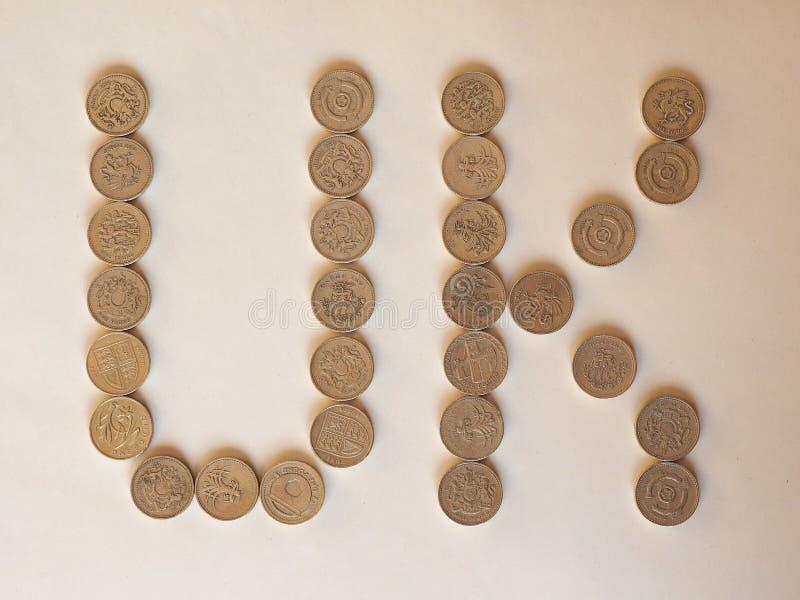 UK Pound coins, United Kingdom. UK written with One Pound coins money (GBP), currency of United Kingdom stock photos
