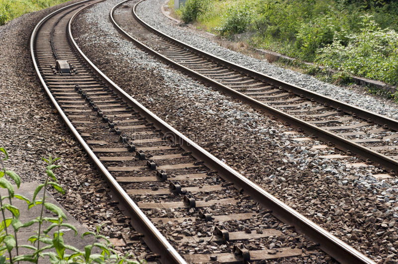 UK railroad / railway. A stretch of UK type railroad / railway with two tracks. Left-hand track has lateral movement prevention. Ballast and concrete sleepers royalty free stock images