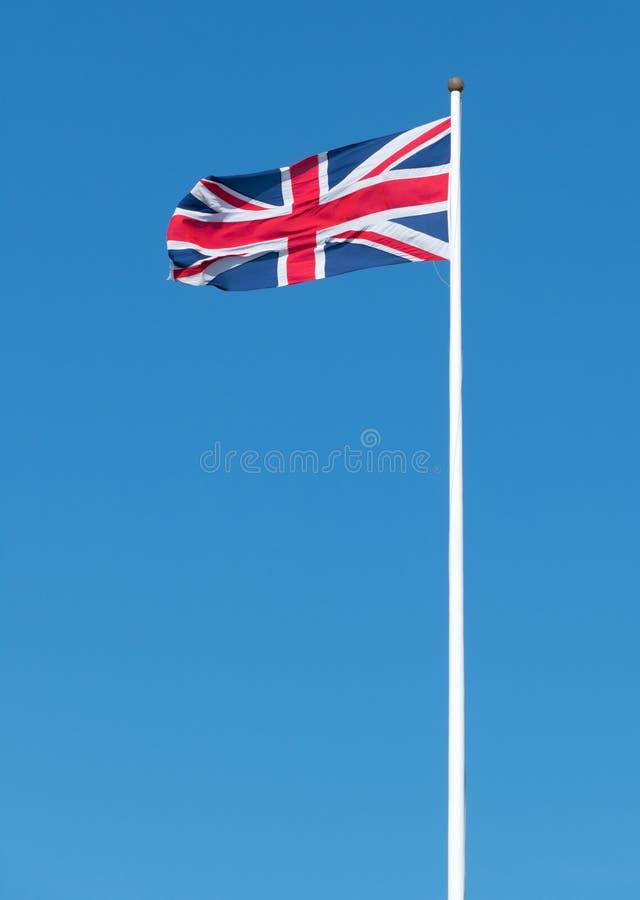 UK Union flag of Great Britain long flagpole. stock photography