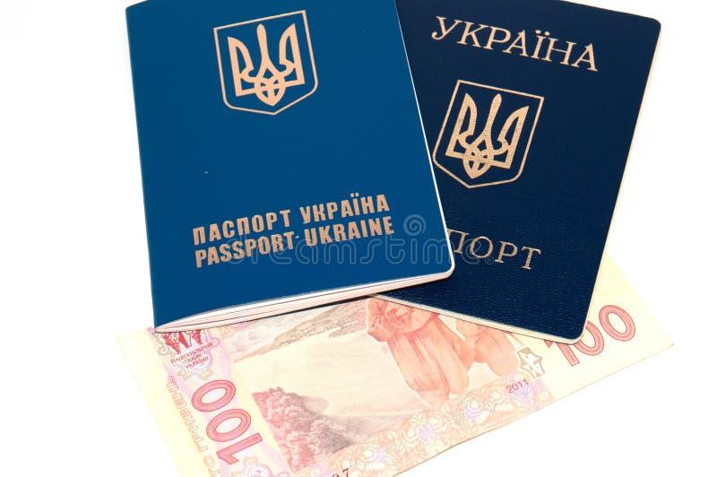 Ukrai?ski paszport i pieni?dze na bia?ym tle, kopii przestrze? zdjęcia royalty free