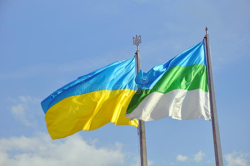 Ukraina i Rivne miasta flag trzepotać zdjęcie stock
