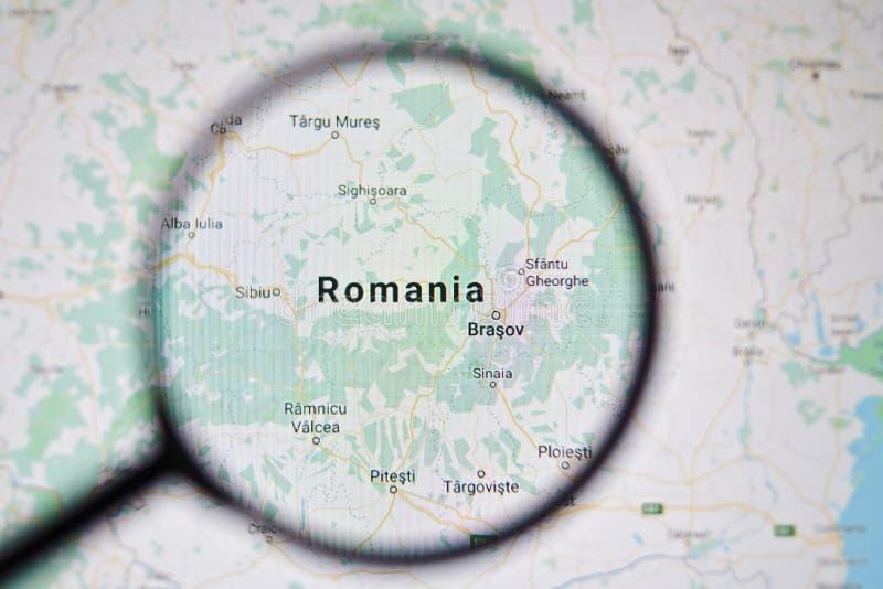 UKRAINA ODESSA - APRIL 25, 2019: Rumänien på Google Maps till och med förstoringsglaset arkivfoto
