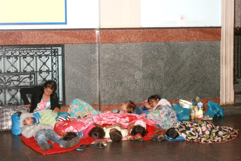 Ukraine, August 2018 Homeless refugees live at the station. A large family of bezentsev sleeping on the street. Children. Suffer from poverty and need help royalty free stock photos