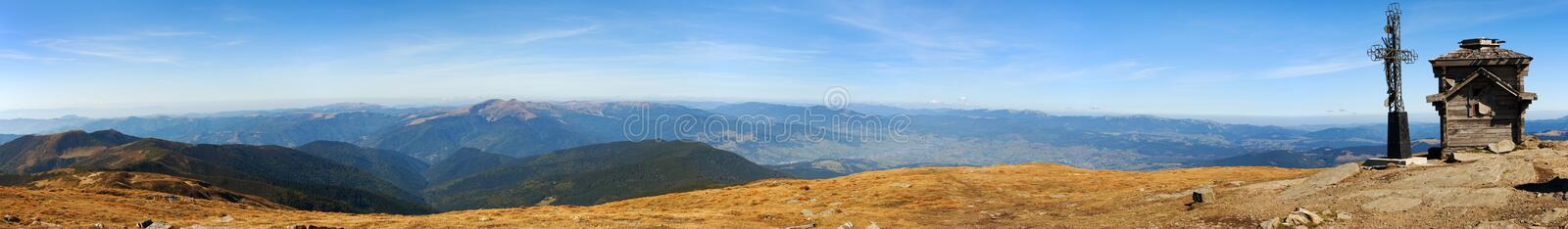 Panoramic view from Ukraine Carpathian mountains with crucigix small chapel stock photo