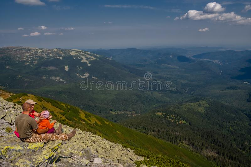 Ukraine, Carpathians - August 26, 2017. A group of tourists on v. Acation at the edge of the mountain royalty free stock photos