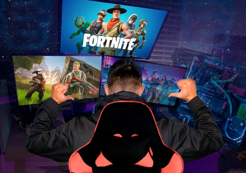 Ukraine, Cherkassy - January 13, 2019: Teenager gamer playing Fortnite video game, Fortnite is a web based multi player survival stock images