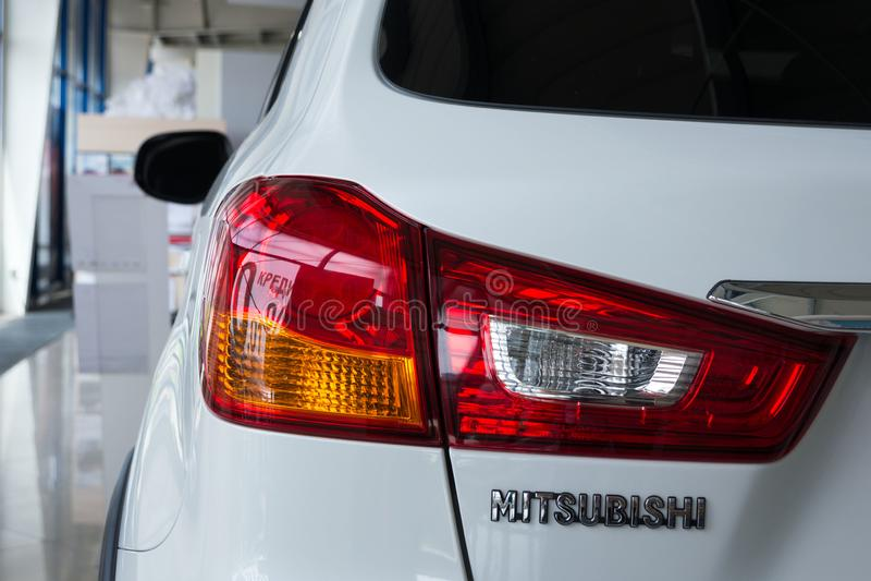 Rear light of a modern white car brand Mitsubishi. Close-up. royalty free stock image