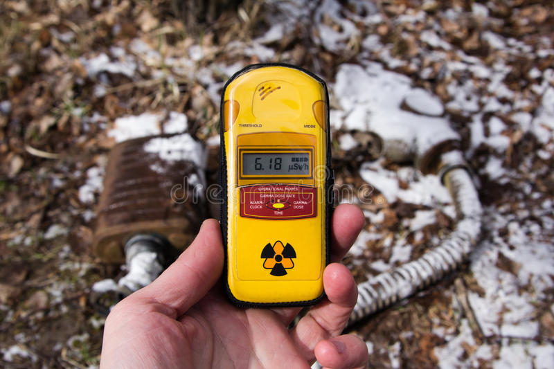UKRAINE. Chernobyl Exclusion Zone. - 2016.03.19. Dosimeter on the background of snow-covered mask stock images