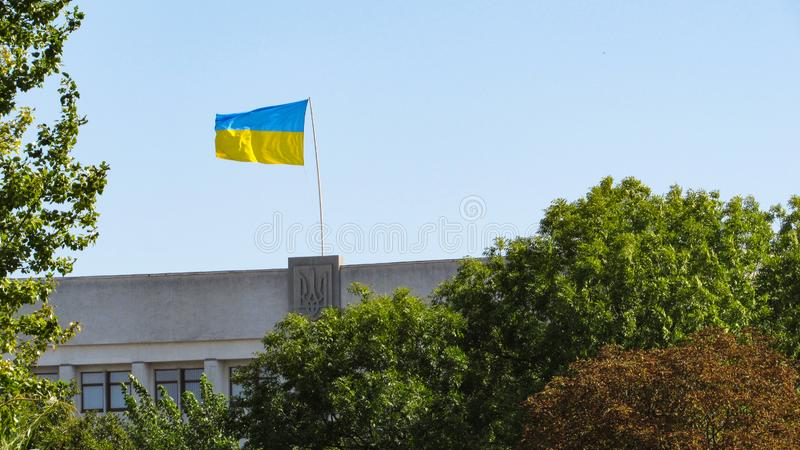 Ukraine flag on sky background. stock image