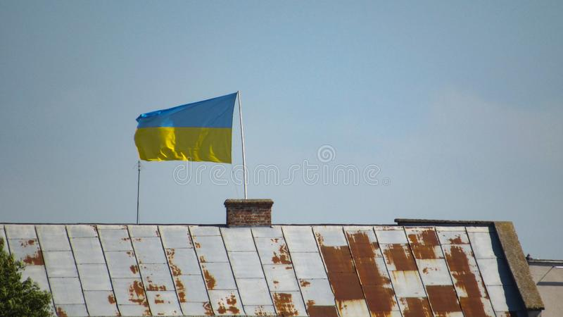Ukraine flag on sky background. stock images