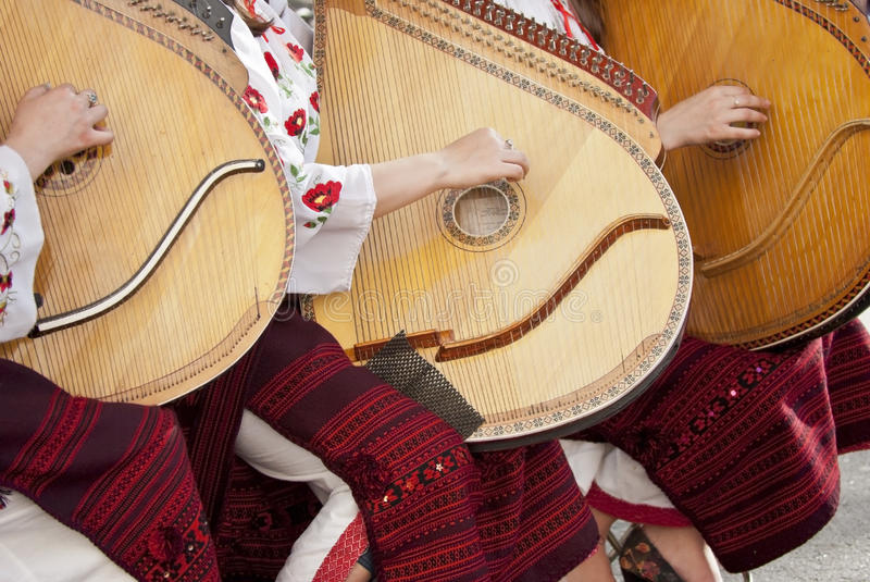 Ukraine girls play a musical instrument. Ukraine girls play a musical stringed instrument royalty free stock images