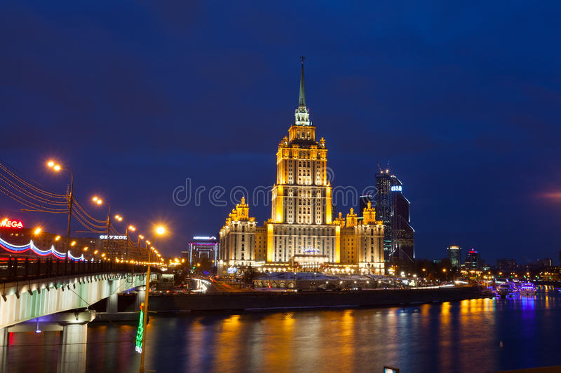 Ukraine hotel (Radisson Royal Hotel) in night illumination. Radisson Royal Hotel - the five-star hotel located in the center of Moscow, in one of Stalin stock images