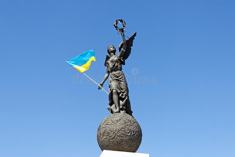 Ukraine Independence Monument in Kharkiv. Monument in honor of the Independence of Ukraine with flag in spring summer day at Constitution square in Kharkiv stock image