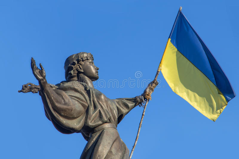 Ukraine Independence Square Statue. Statue of a young girl that stands in Kievs Independence Square, that was modified by the EuroMaidan protesters of 2014 to stock image