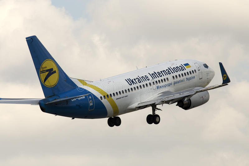 Ukraine International Airlines Boeing 737-500 aircraft on the cloudy sky background stock photography