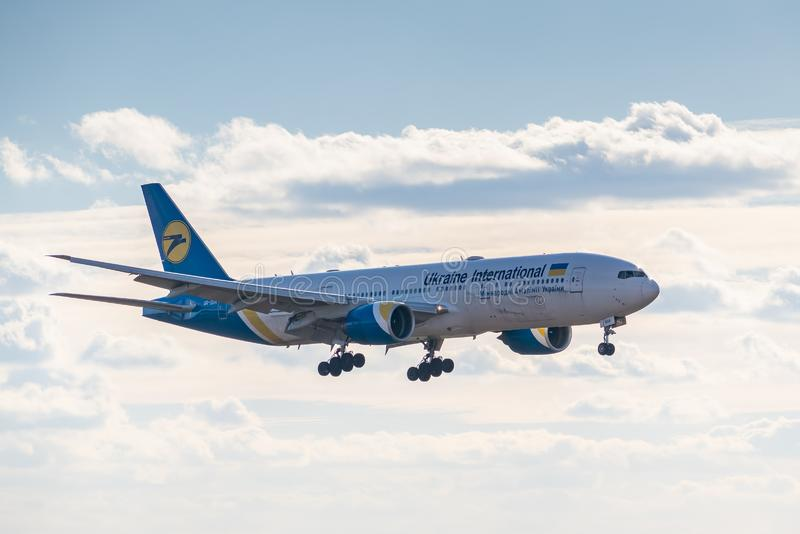 Ukraine International Airlines Boeing B777. Kyiv, Ukraine - March 17, 2019: Ukraine International Airlines Boeing B777 on short final landing in the airport royalty free stock photos