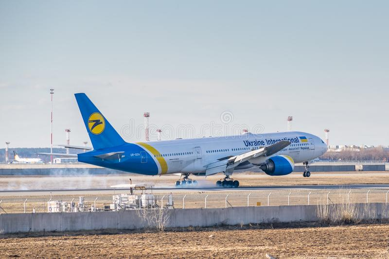 Ukraine International Airlines Boeing B777. Kyiv, Ukraine - March 17, 2019: Ukraine International Airlines Boeing B777 on short final landing in the airport royalty free stock images