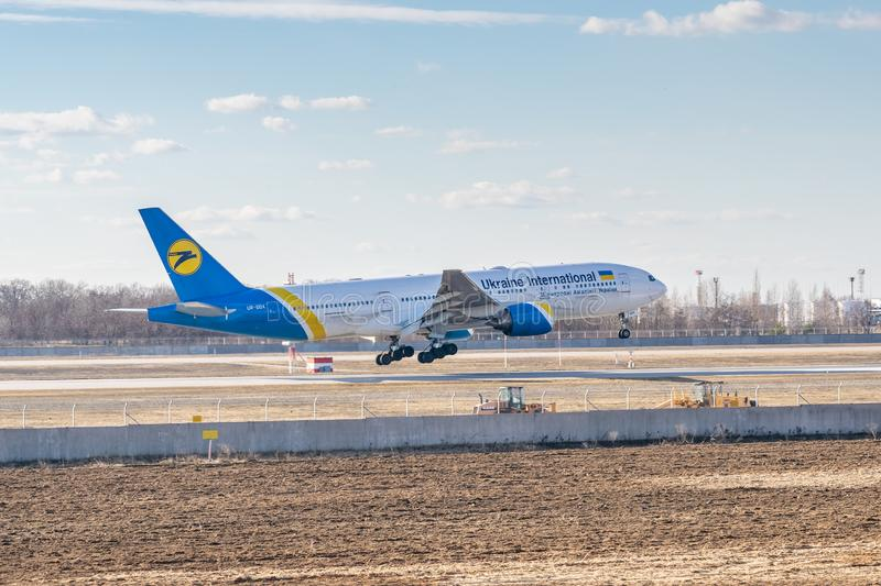 Ukraine International Airlines Boeing B777. Kyiv, Ukraine - March 17, 2019: Ukraine International Airlines Boeing B777 on short final landing in the airport stock images