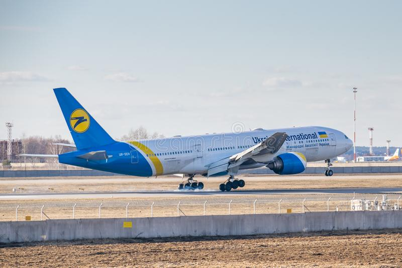 Ukraine International Airlines Boeing B777. Kyiv, Ukraine - March 17, 2019: Ukraine International Airlines Boeing B777 on short final landing in the airport royalty free stock image