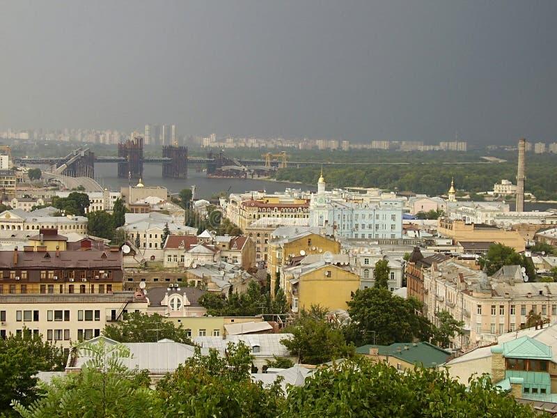 Ukraine, Kiev, 2010, Andreevskaya church, Golden domes, Dnepr River. Thunderstorm, wich mountain, rain, clouds, bridge, architecture stock images