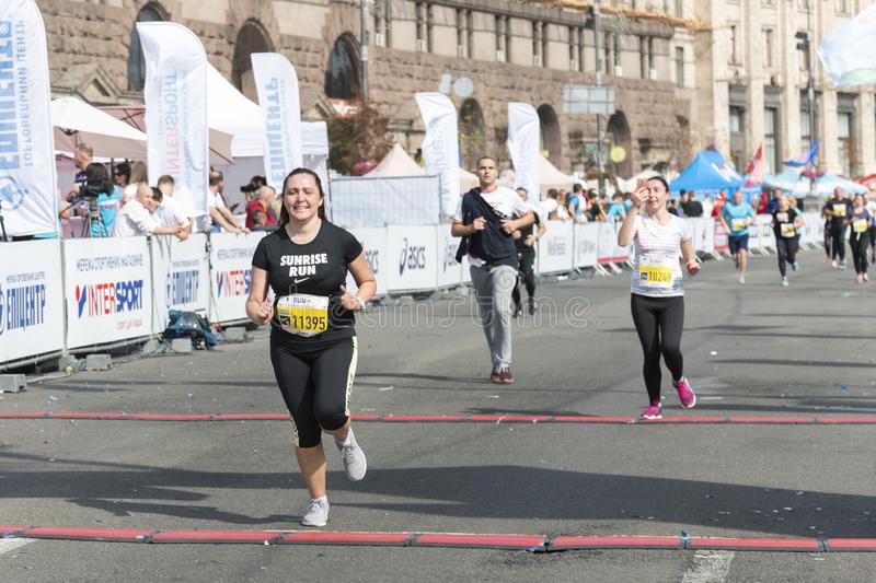 Ukraine, Kiev, Ukraine 09.09.2018 athletes and amateurs are running. People are engaged in running. Promotion of healthy stock illustration