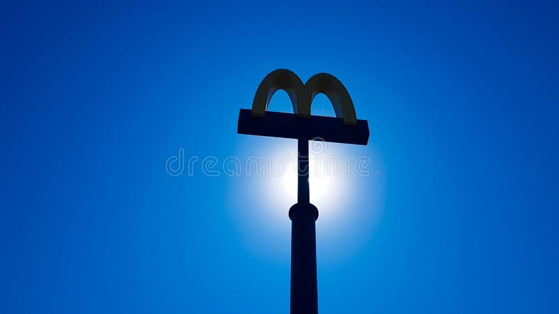 Ukraine, Kiev - August 23, 2019: McDonalds logo against the sky. McDonald`s Corporation is the world`s largest chain of hamburge stock photo
