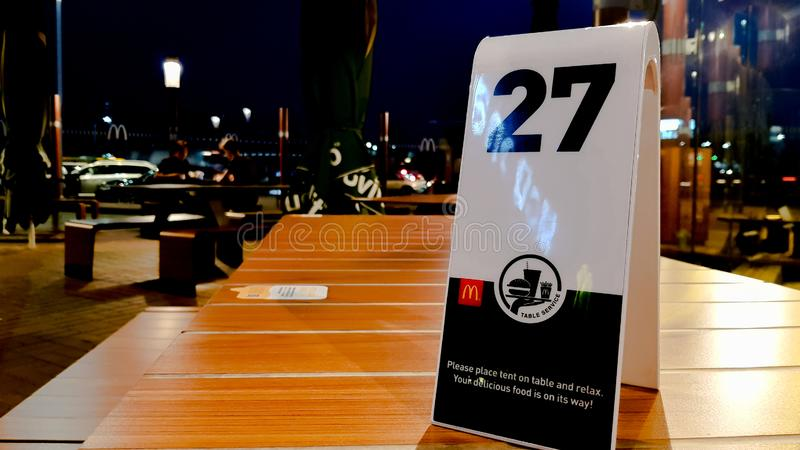 Ukraine, Kiev - August 23, 2019 - order number on the table at McDonald`s restaurant. Awaiting order at McDonald`s Restaurant stock image