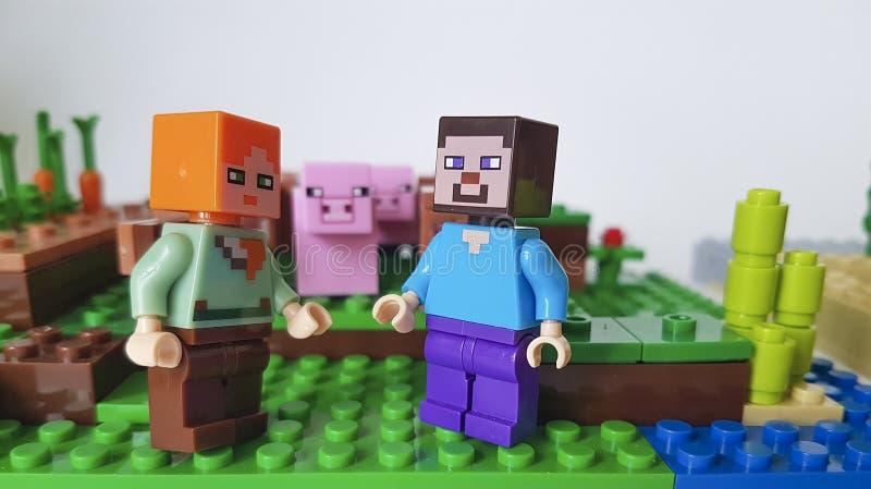 Ukraine Kiev February 21 2018 mini figure pig farm sword man plastic game popular childhood Lego Minecraft square royalty free stock images