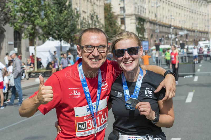 Ukraine, Kiev, Ukraine 09.09.2018 A happy couple of runners after a marathon. Happy weak-minded runners after running stock images