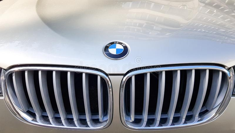 Ukraine, Kiev - June 16, 2019: View of the front grille of a BMW. Prestigious car brand. Close-up grille of a golden SUV car. Logo. BMW X5 sign stock images