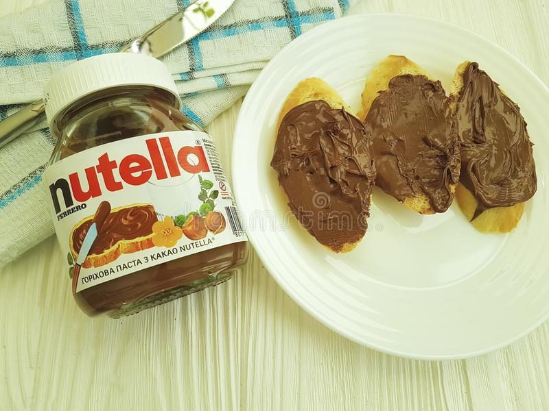 Ukraine Kiev10 March 2018 Nutella hazelnut chocolate on the wooden breakfast morning creamy royalty free stock images