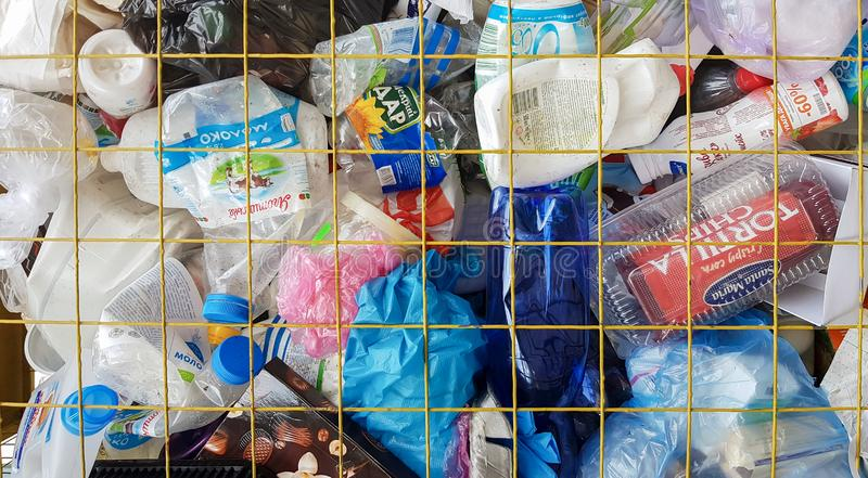Ukraine, Kiev - October 7, 2019: Plastic bottles are stored in cages for recycling. Many plastic bottles and cans in cages for stock photography