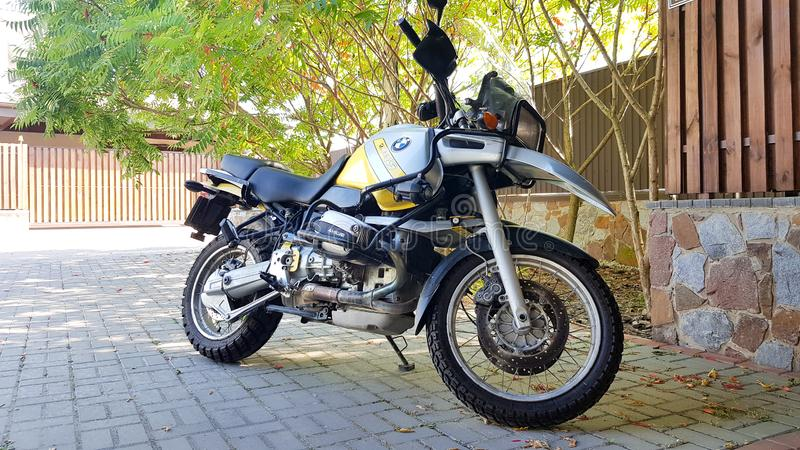 Ukraine, Kiev - September 10, 2019: BMW motorcycle is parked in the courtyard of the house.  royalty free stock photo
