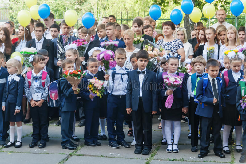 Ukraine.Kiev - September 1, 2016. First-graders and other studen. Ts on the line near the school stock image