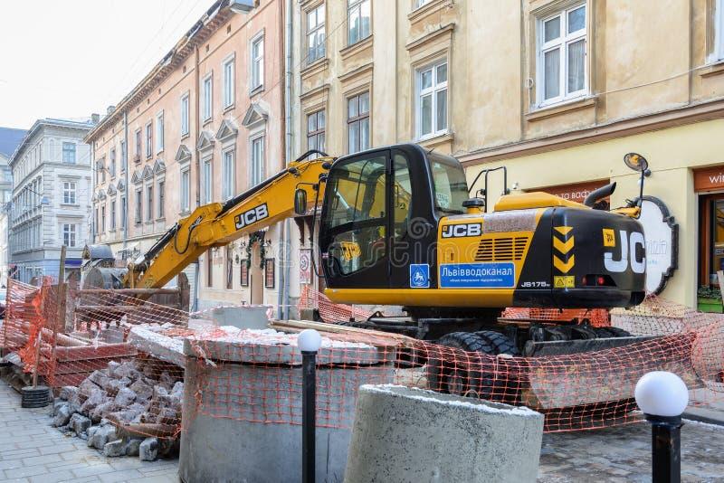 Ukraine, Lviv - December, 17, 2016: Repair of the aqueduct in th royalty free stock photos