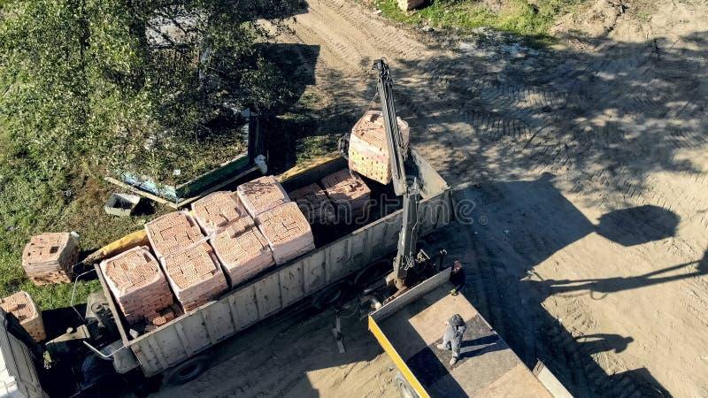 UKRAINE LVIV December 29th 2018. Aerial view the truck unloads t stock image