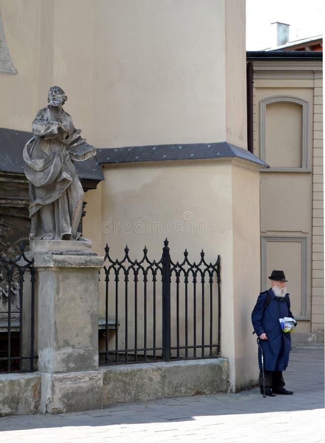 Ukraine,Lviv, Latin Cathedral-September 25, 2011: Beggar, elderly man with a beard, begging alms stock photos