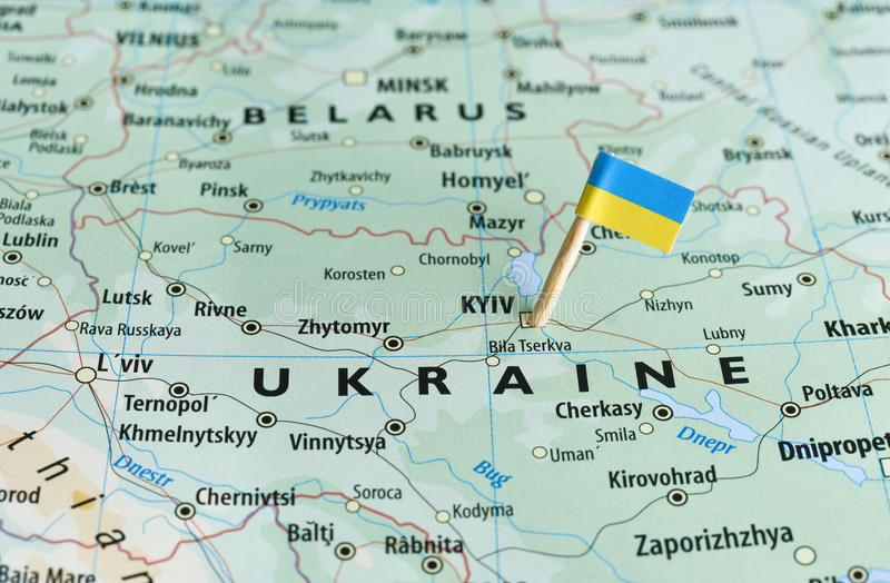 Ukraine map flag pin. Closeup shot of Ukraine map and flagpin royalty free stock image