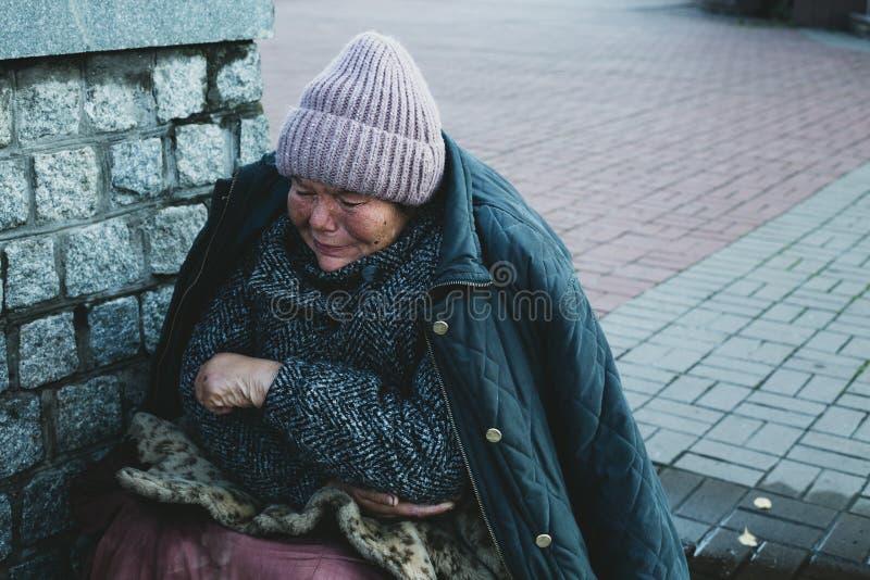 Ukraine November 12, 2019. Crying homeless woman stock photo
