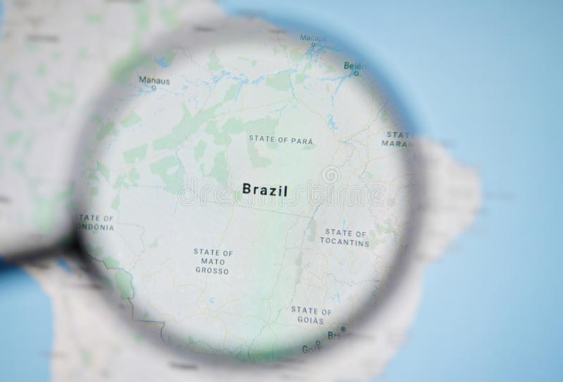 UKRAINE, ODESSA - APRIL 25, 2019: Brazil on google maps. Through magnifying glass royalty free stock image