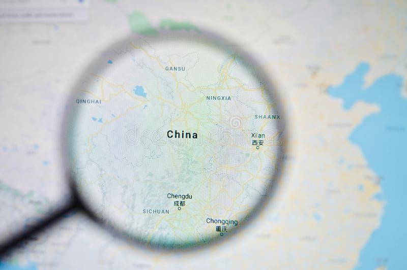 UKRAINE, ODESSA - APRIL 25, 2019: China on google maps through magnifying glass. UKRAINE, ODESSA - APRIL 25, 2019: China on google maps through magnifying glass stock image