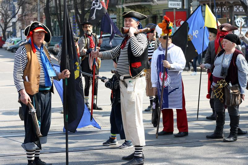Ukraine, Odessa - April 1, 2019, a costume parade dedicated to the Day of Laughter and Humor. Humorina People in pirate costumes. With flags stock images