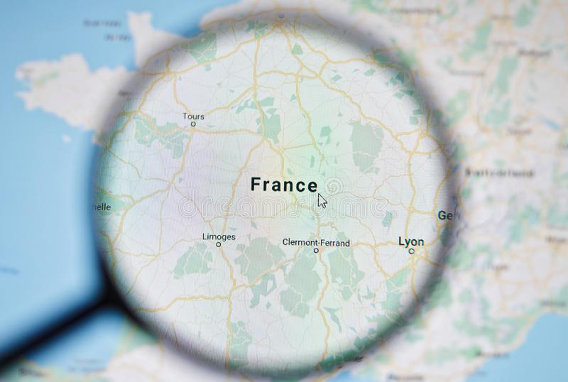 UKRAINE, ODESSA - APRIL 25, 2019: France on google maps through magnifying glass. UKRAINE, ODESSA - APRIL 25, 2019: France on google maps through magnifying royalty free stock photo