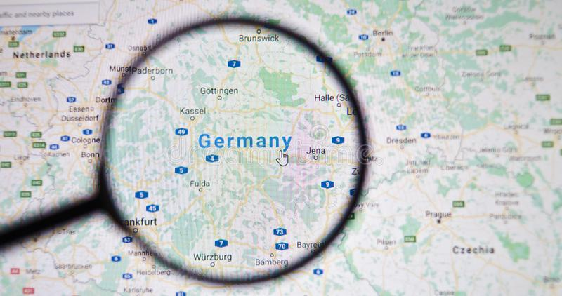 UKRAINE, ODESSA - APRIL 25, 2019: Germany on google maps through magnifying glass. UKRAINE, ODESSA - APRIL 25, 2019: Germany on google maps through magnifying stock photography