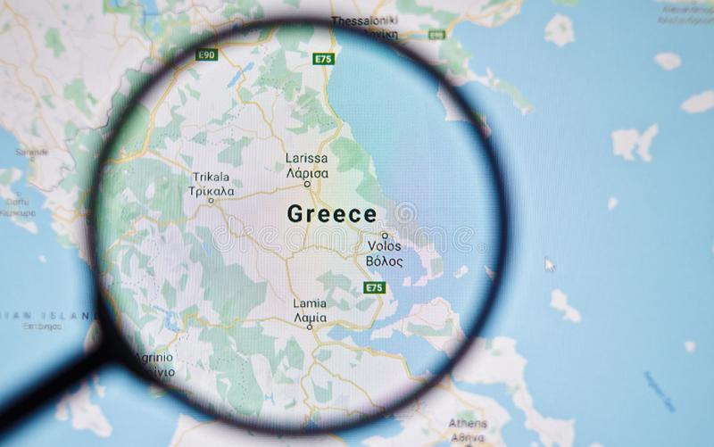 UKRAINE, ODESSA - APRIL 25, 2019: Greece on google maps through magnifying glass. UKRAINE, ODESSA - APRIL 25, 2019: Greece on google maps through magnifying stock image